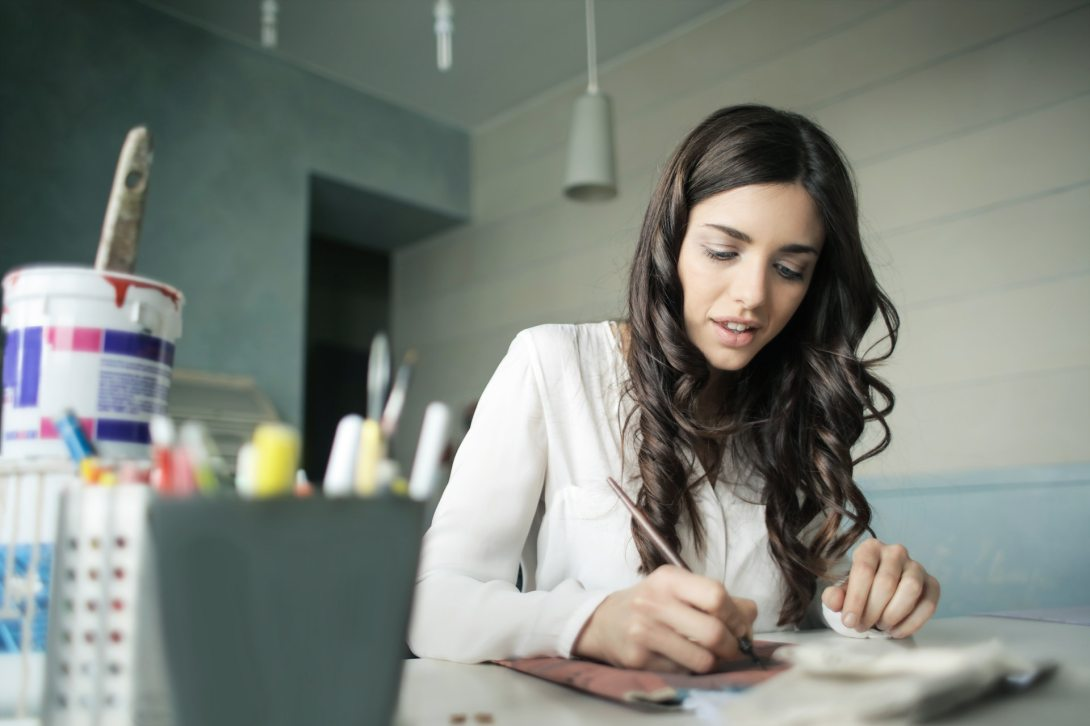 woman writing seo content