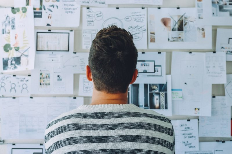 man working on creating online business strategy